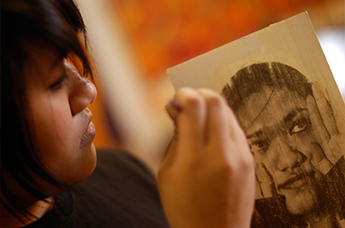 Young artist working on a self-portrait. Courtesy RAW Art Works.